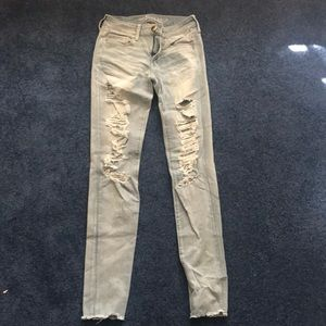 America Eagle 4 Long Distressed Light Wash Jeans